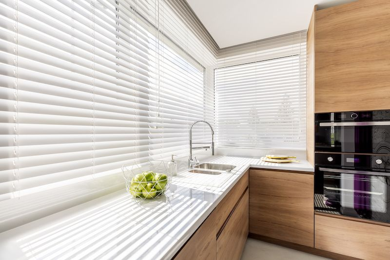 Kitchen with white blinds.