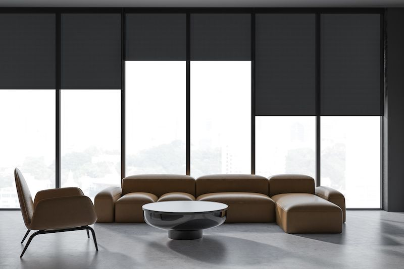 Minimalist living room with dark shades.