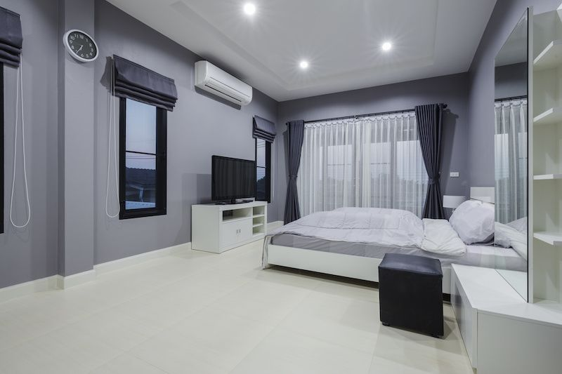 Very modern and clean bedroom with curtains.
