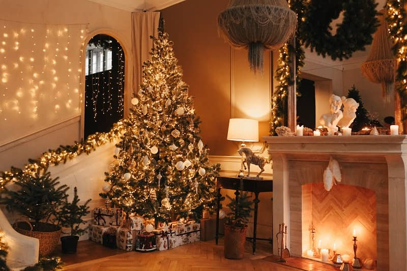 cozy christmas tree by fireplace