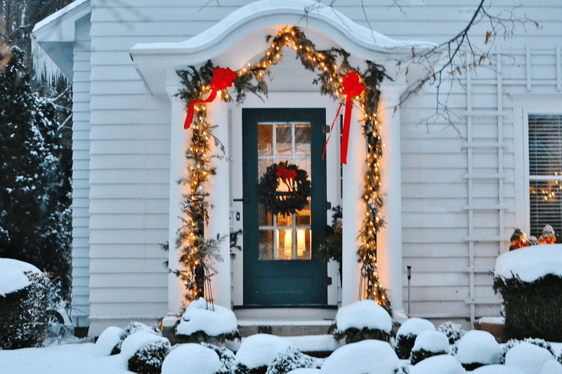 holiday lights on snowy front door