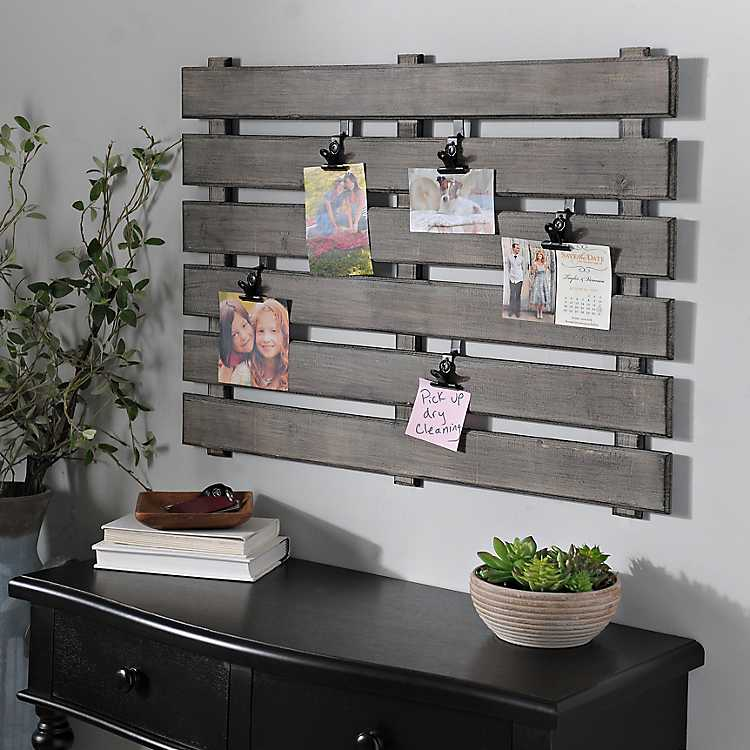 Picture collage hanger made of wooden slats to look like a fence.