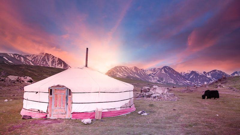 Mongolian Yurt in a field near the mountains