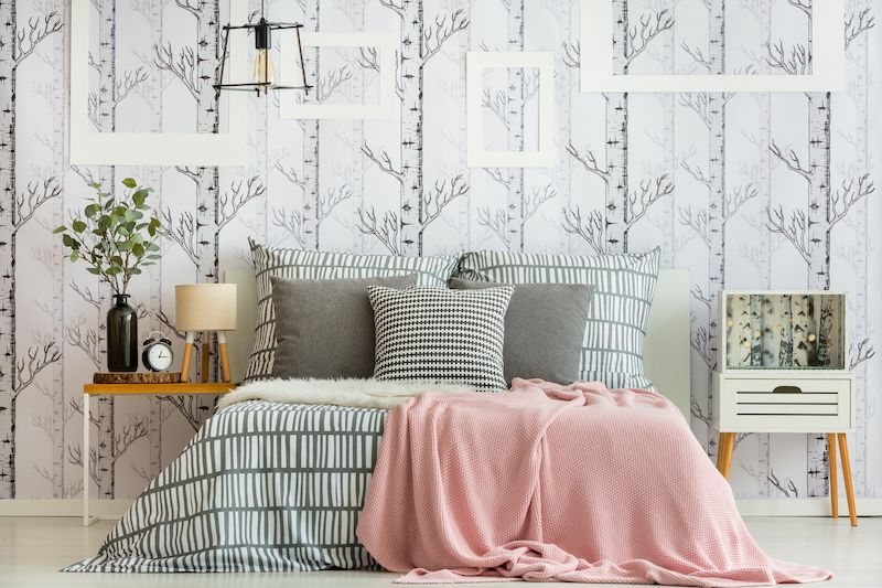 Bedroom with multiple patterns incorporated into decor.