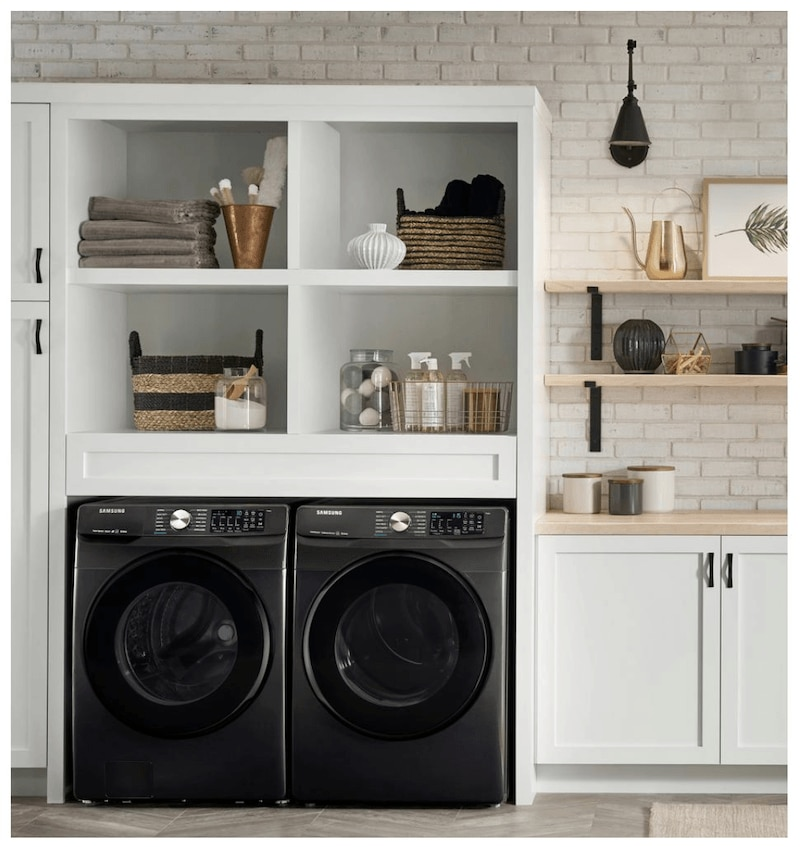 Samsung black washer dryer set in laundry room.