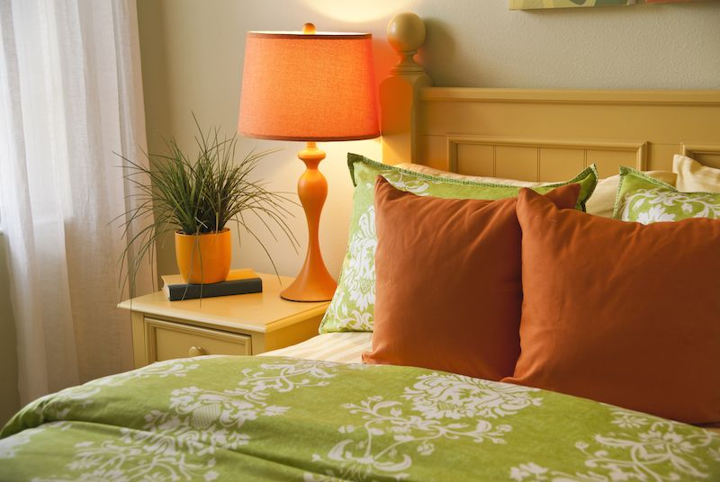 Bright colored room with orange and green.