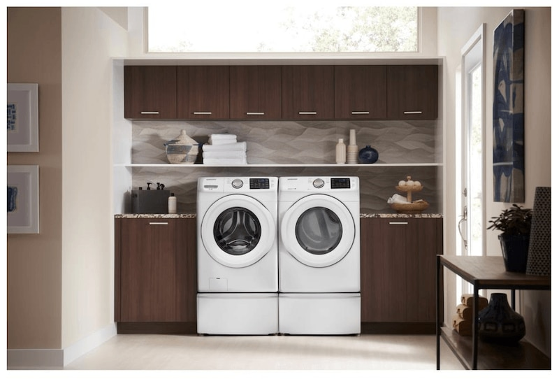 Samsung white set of washer and dryer in laundry room.