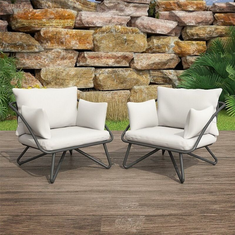 midcentury style lounge chairs with beige cuchions