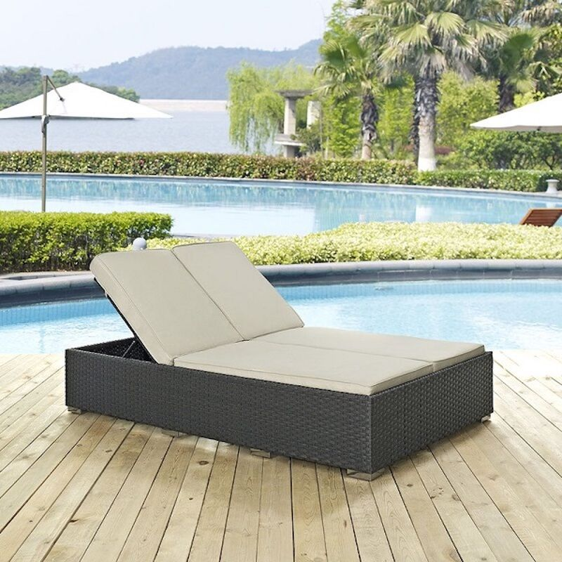 outdoor chaise chair on a deck by a pool