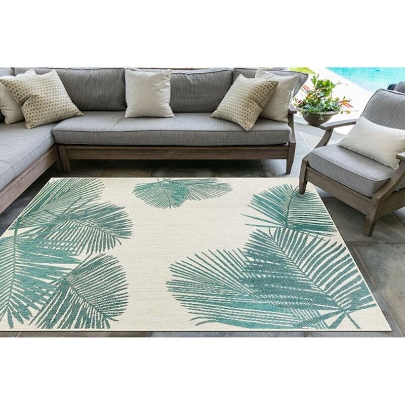 large outdoor rug with palm tree designs