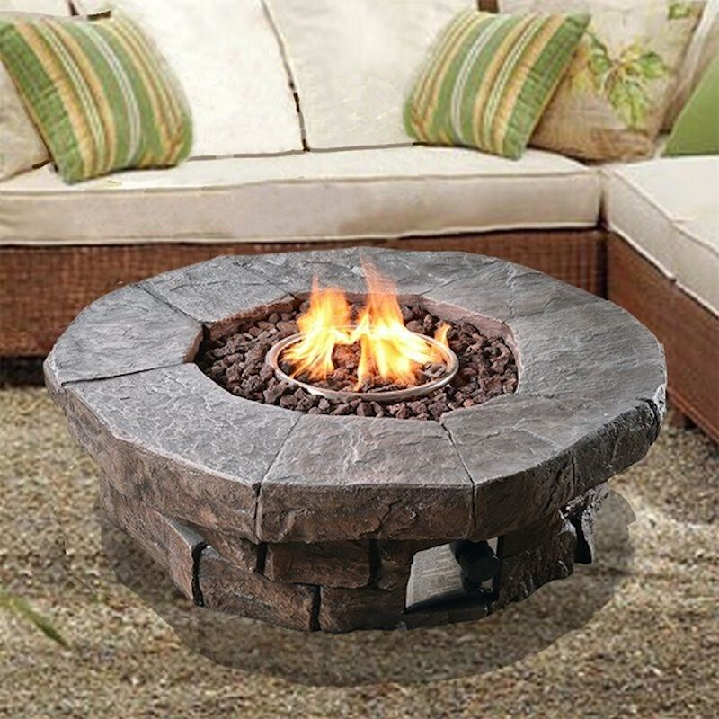 fire pit with outdoor furniture around on a pool deck