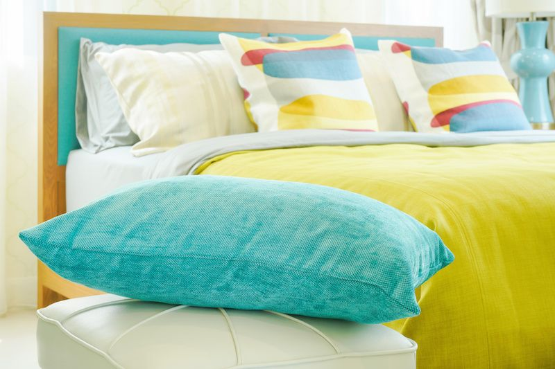 Bright colored pillows in a bedroom
