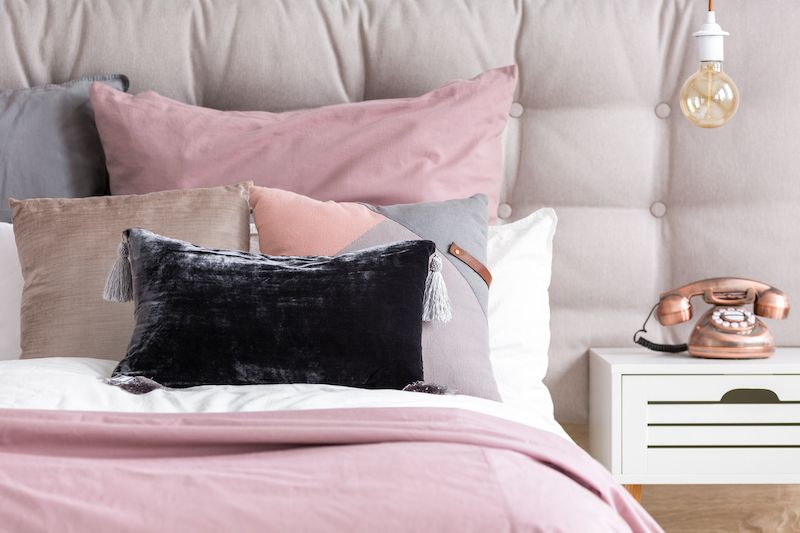 Bed pillows and blankets with different textures.