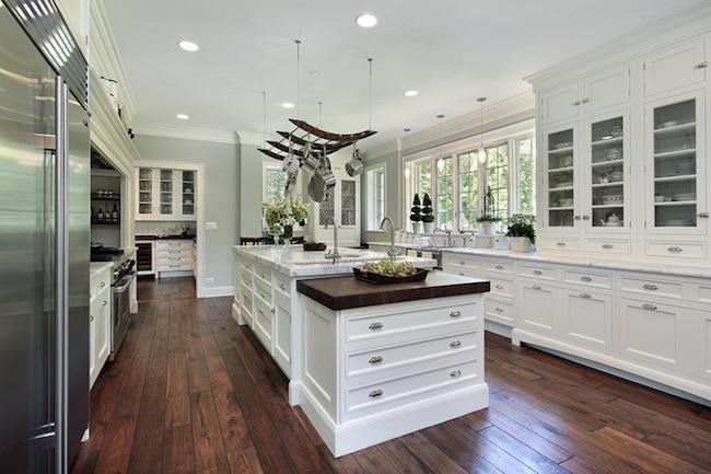 white kitchen with hardwood flooring
