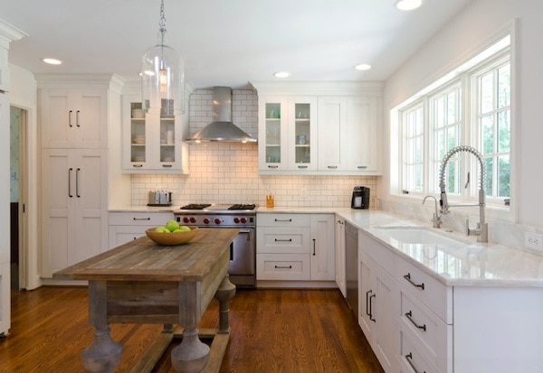 white kitchen with hardwood floors and lighting under cabinets