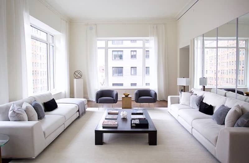 gray living room with city view