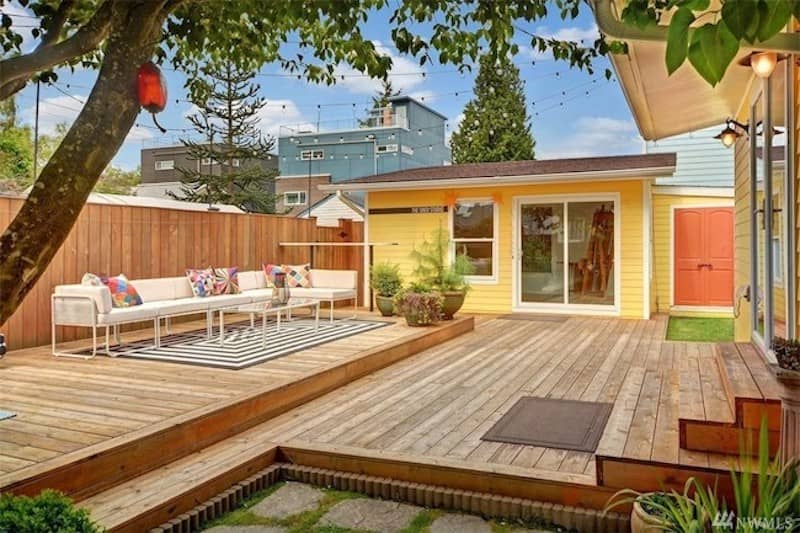 back yard filled with wood patio